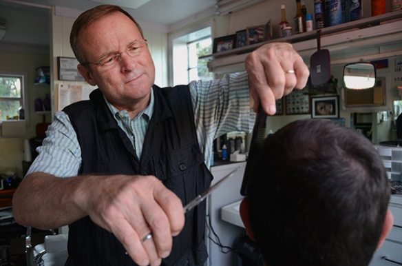 Barber Bill Goolsby poses for a potrait at Kutters Barber Shop in Gainesville, Fla.