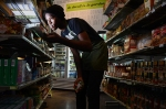 Robert, a worker-owner at Citizens Co-op, stocks product on the shelves.