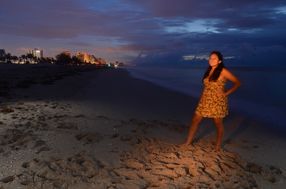 My friend Alex poses for a photo on a beach in Fort Lauderdale while I and two assistants paint her with light.